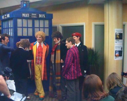 A soslovie of ersatz Doctors gather outside a replica TARDIS at the Time Quest 2 convention in Theobalds park