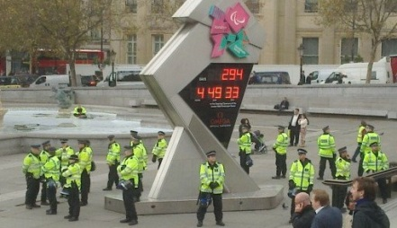 Police protect the Olympic countdown clock
