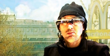Foreground: Steve Mann, cyborg / background: McDonalds sign, Champs-Élysées