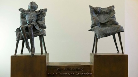 Statue commemorating thalidomide survivors - text reads: In memory of the dead and living, photo by Jens Schlueter